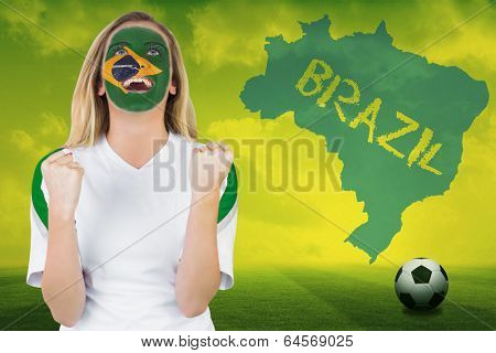 Excited brasil fan in face paint cheering against football pitch with brazil outline and text