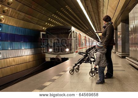 Mother With Son At Subway Station