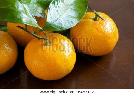 Mandarin Oranges On Wooden Table