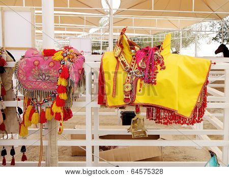A beautiful colorful yellow saddle and pads for horse
