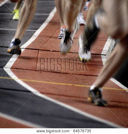 Runner running a race around a track with  lines