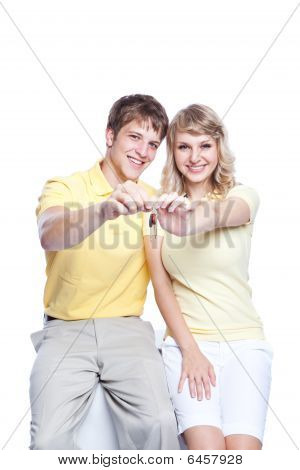 Young Couple Holding A Set Of Keys