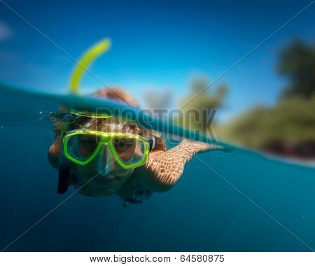 Lady snorkeling in a sea
