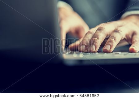Businessman Typing On A Laptop Computer
