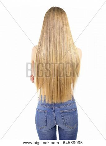 Hair. Beautiful woman with long healthy shiny smooth hair. Back view of blond girl in jeans over white background. Gorgeous Hair. Hair care.
