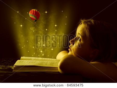 Teen girl reading the Book