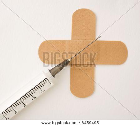 Syringe And Plaster Cross