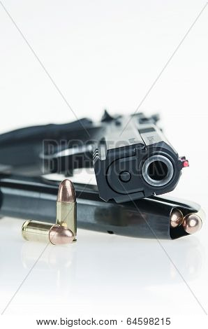 Pistol, magazine and bullets