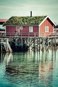 picture of reining  - Typical Norwegian fishing village with traditional red rorbu huts Reine Lofoten Islands Norway - JPG