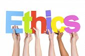 stock photo of ethics  - Diverse Hands Holding The Word Ethics - JPG
