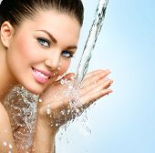 foto of beauty  - Beautiful Model Woman with splashes of water in her hands - JPG