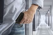foto of outlaw  - Man holding gun against an corridor background - JPG