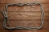 pic of roping  - frame of rope on the background of wooden boards - JPG