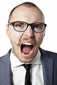 stock photo of berserk  - Portrait of an angry businessman - JPG