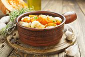 stock photo of stew pot  - Pumpkin baked with chicken in the ceramic pot - JPG