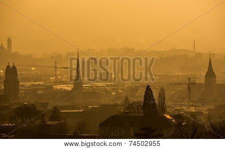 View of Zurich from above - misty winter evening and smoke