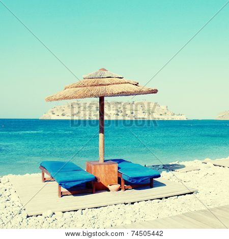 Sun Beds And Umbrellas On The Beach Of Mediterranean Sea (Crete,