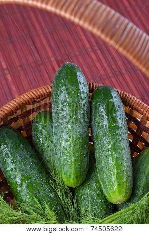 green cucumbers in a wicker basket