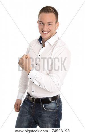 Successful cheering isolated young blond man making fist gesture with hands.