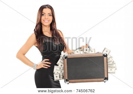 Attractive woman holding a briefcase full of money isolated on white background