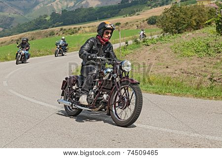 Biker Rides An Old Moto Guzzi Of The Thirties