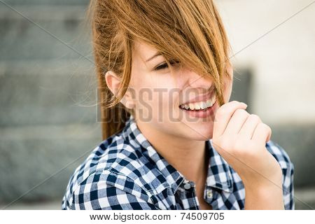Young woman playing with hair
