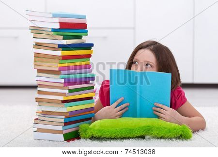 Young student worried by the volume of knowledge she has to learn