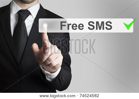 Businessman Pushing Flat Touchscreen Button Free Sms