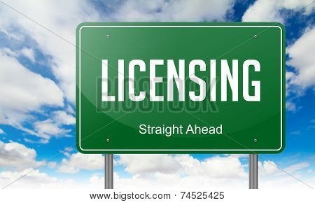 Licensing on Green Highway Signpost.