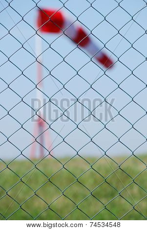 Buoy Wind Behind Fence