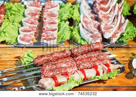 Skewers Of Raw Shish Kebabs And Lamb Meat