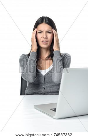 Young Woman With Headache Facing Laptop