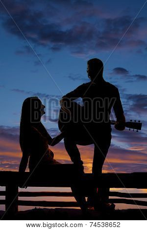 Silhouette Woman Sit By Man With Guitar
