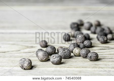 Close-up of allspice peas and the star anise on a wooden background