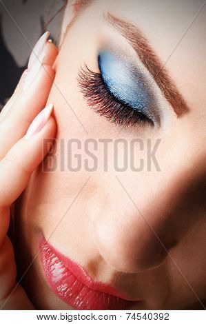 Closeup of a closed woman eye with fake eyelashes