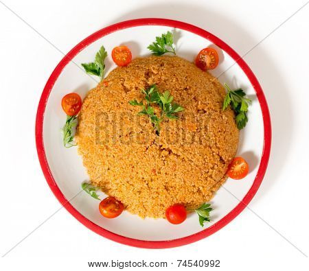 turkish bulgur pilaf made with bulgur, or burghul, wheat, onion, capsicum, and tomato, This is a staple of Turkish cuisine.