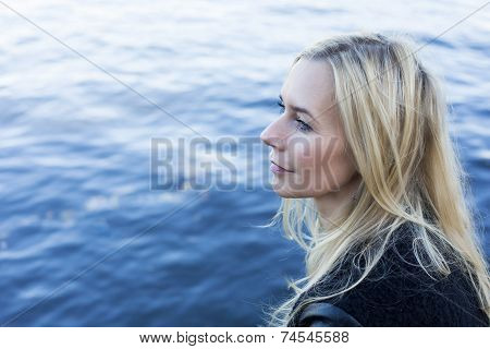 Blond Woman By The Waterfront