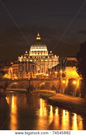 Monumental St. Peters Basilica over Tiber  at night  in Rome, Italy