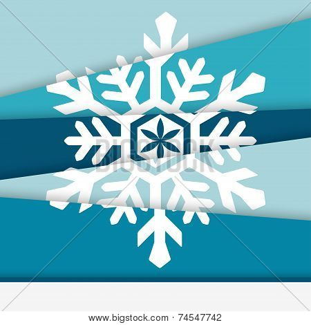 Creative New year card. Asymmetric snowflake formed from paper