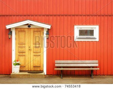 Wooden Yellow Door In Orange Colored Building