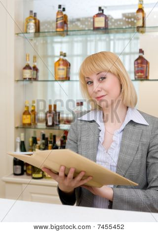 Barmaid At A Bar With Wine List
