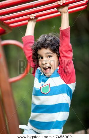 Boy Playing At The Park