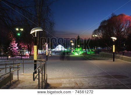 Evening Illumination In Winter City Park.