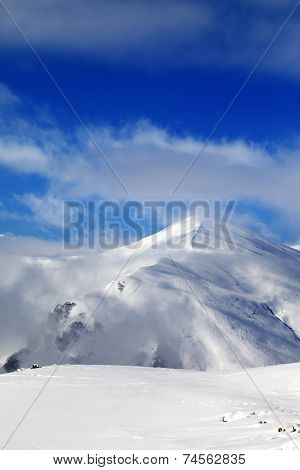 Off-piste Slope And Blue Sky With Clouds At Sunny Day