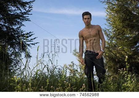 Gorgeous Young Topless Man At The Garden