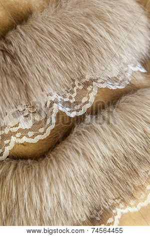Product from natural fur with finishing from lace