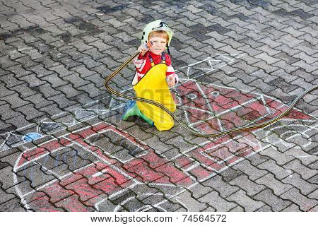 Funny Little Child Of Four Years Having Fun With Fire Truck Picture Drawing With Chalk.