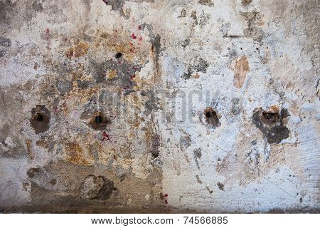 Old Wall With Visible Rusty Cut Edges Of The Reinforcement Bars