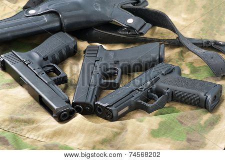 Set of different guns on background for shooting