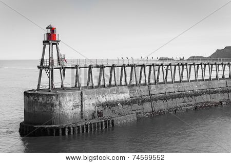 Scenic view of Whitby Pier in sunny autumn day, UK